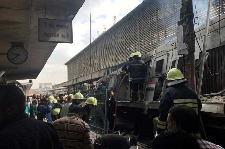 Rescue workers seen after a fire caused deaths and injuries at the main train station in Cairo, Egypt, on Feb 27, 2019.