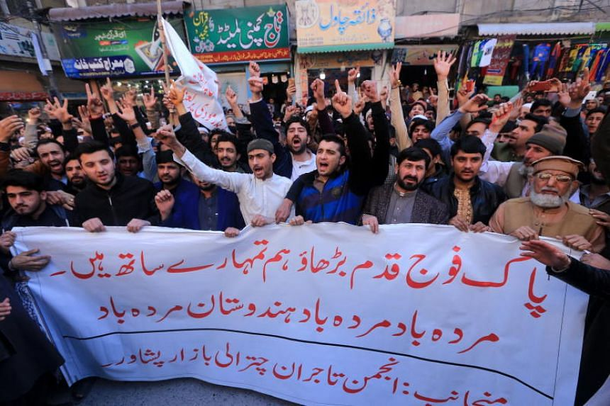 People shout slogans during an anti-Indian protest in Peshawar, Pakistan, on Feb 27, 2019.