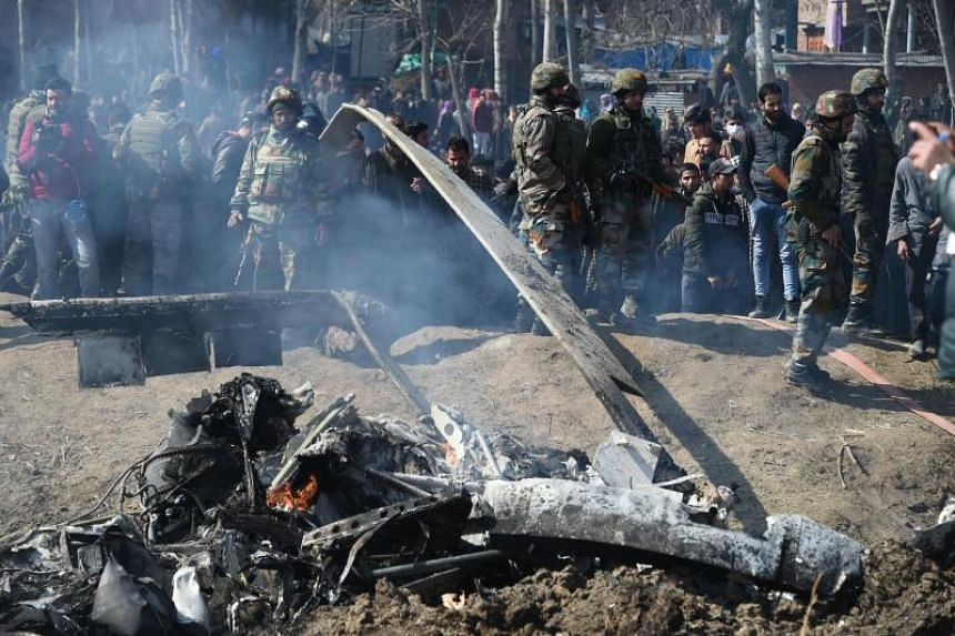 Police officials on the Indian side of Kashmir said that two Indian pilots and a civilian had died after an Indian air force plane crashed in Kashmir.