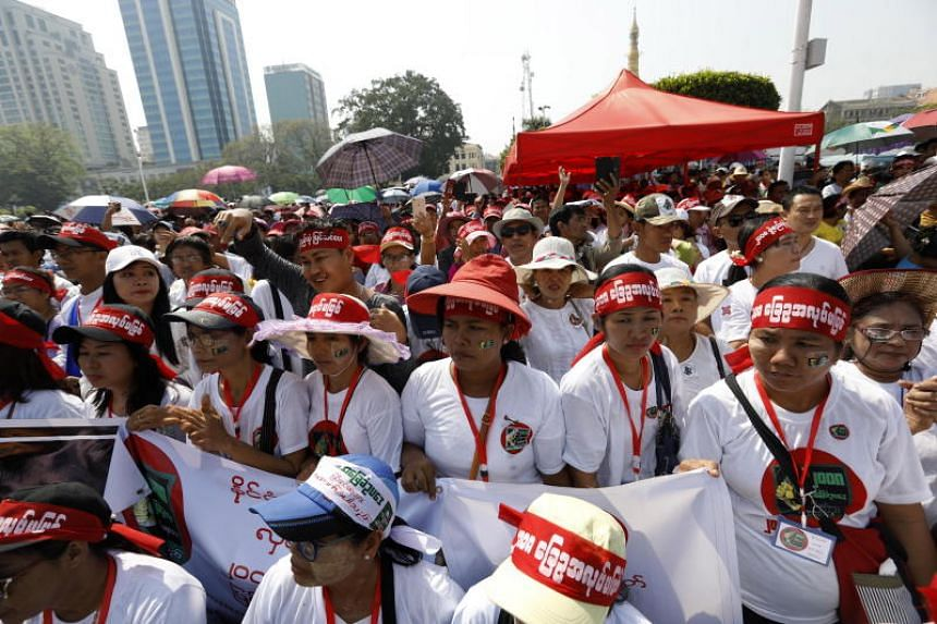 People wearing head bands participate in a protest to support amending the constitution of Myanmar in Yangon, on Feb 27, 2019.