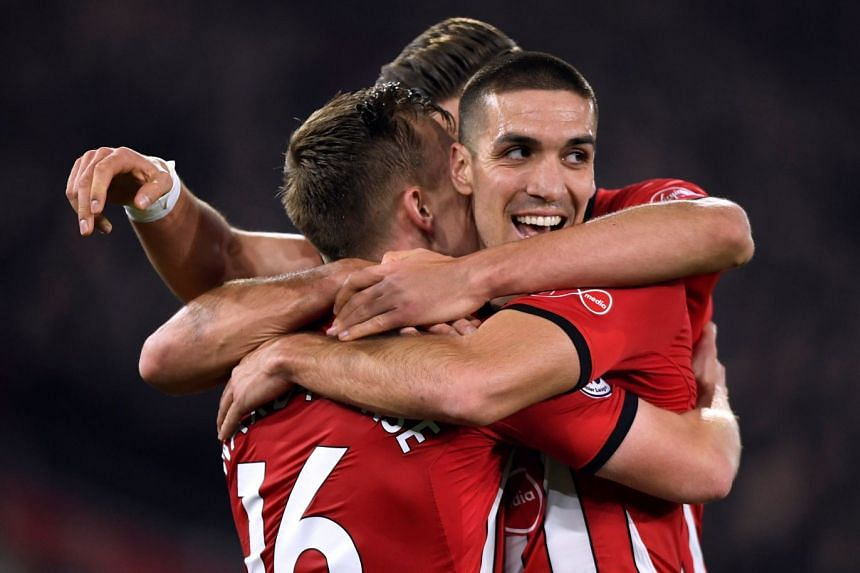 Southampton's James Ward-Prowse celebrates scoring their second goal with Oriol Romeu and team mates.