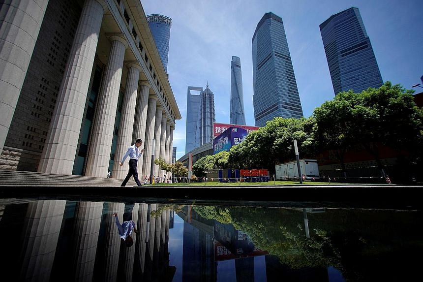 The Lujiazui financial district of Pudong in Shanghai. Attracting global funds is a key part of Chinese President Xi Jinping's push to build a more institutionally driven financial system that is less prone to the boom-and-bust cycles that have plagu