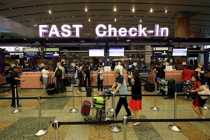 Passengers at Changi Airport's check-in counters. The Department of Statistics said revenue growth for business services - which include real estate, travel, security and professional services - cooled to 1.3 per cent in the fourth quarter of last ye