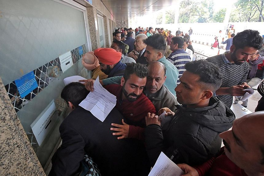 The crowd at an airport ticket counter in Jammu after flights were suspended following airspace closure by India and Pakistan yesterday.