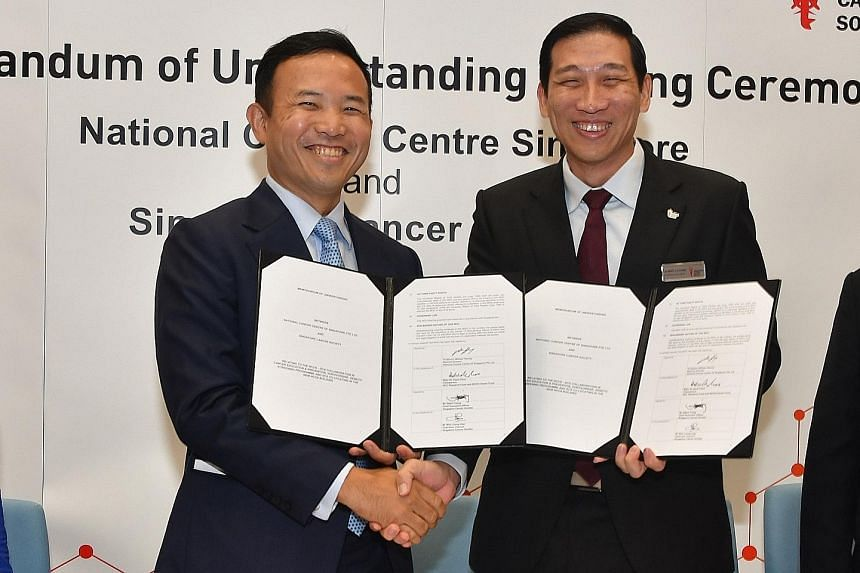 National Cancer Centre Singapore medical director William Hwang (left) and Singapore Cancer Society chief executive Albert Ching at the signing of a memorandum of understanding yesterday.