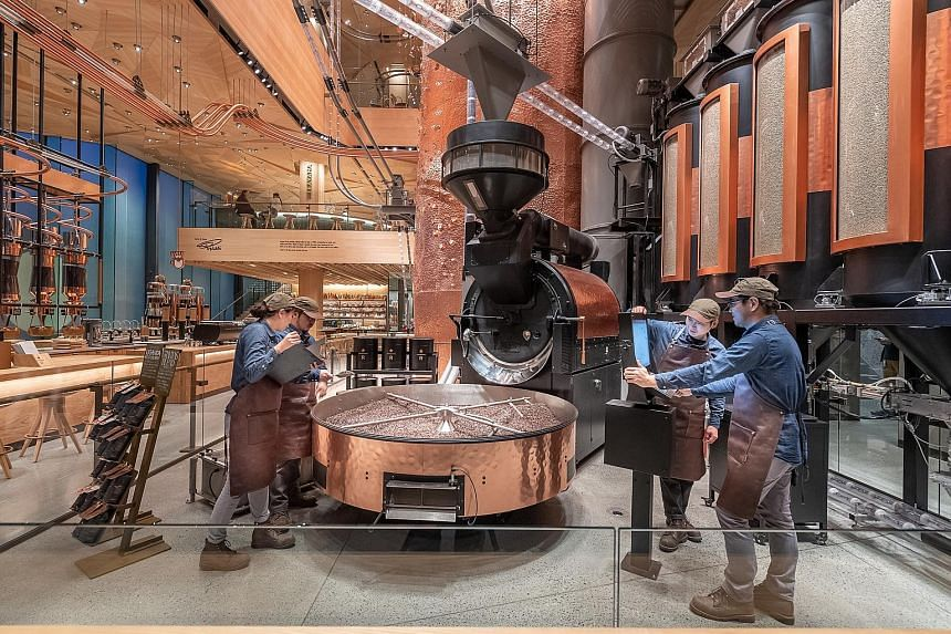 More than 680,000kg of coffee a year is expected to be roasted at the Starbucks Reserve Roastery (above and top), which has an origami-inspired wooden-tiled ceiling to celebrate Japanese craftsmanship.