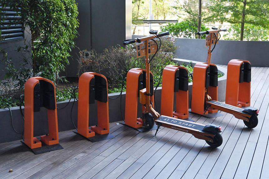 Neuron Mobility e-scooters parked outside the Ascent building in Science Park Drive on Feb 12, 2019.