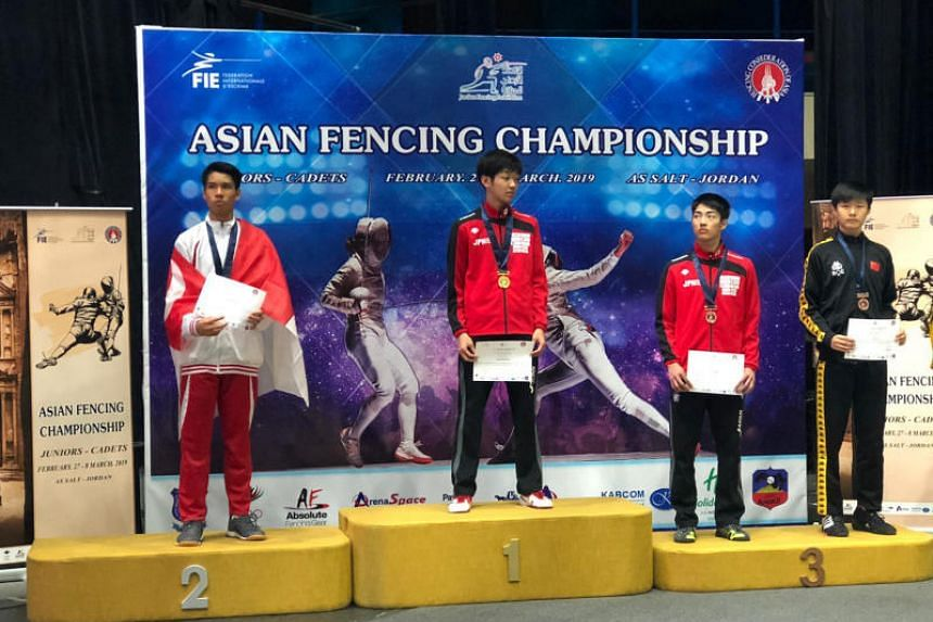 Singapore's Simon Lee (left) won a silver medal in the cadet men's epee at the Asian Junior and Cadet Fencing Championship in Amman, Jordan on Feb 27, 2019.