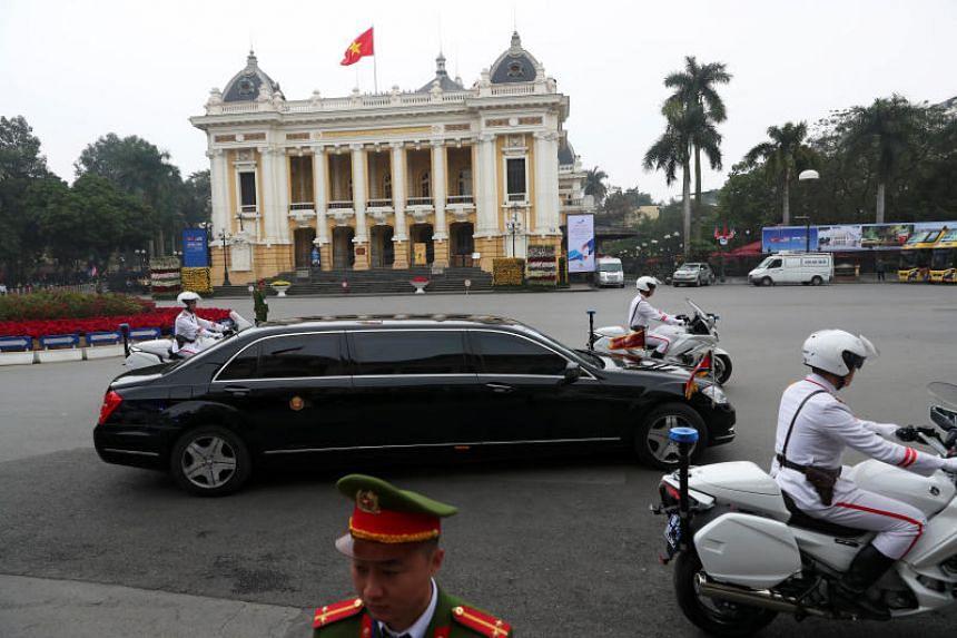 A motorcade transporting North Korean leader Kim Jong Un passes the Opera House after leaving Hanoi's Sofitel Legend Metropole hotel following the second US-North Korea summit on Feb 28, 2019.