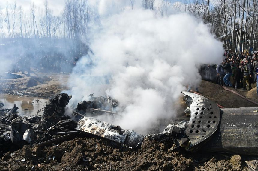 Smokes billows from the remains of an Indian Air Force helicopter after it crashed in Budgam district, on the outskirts of Srinagar, on Feb 27, 2019.