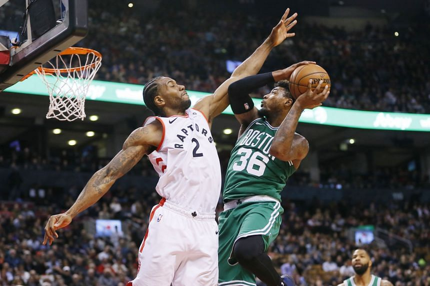 Toronto Raptors forward Kawhi Leonard trying to block a shot by Boston Celtics guard Marcus Smart at the Scotiabank Arena on Tuesday night. The Raptors won the National Basketball Association game 118-95 to record their eight straight home victory ov
