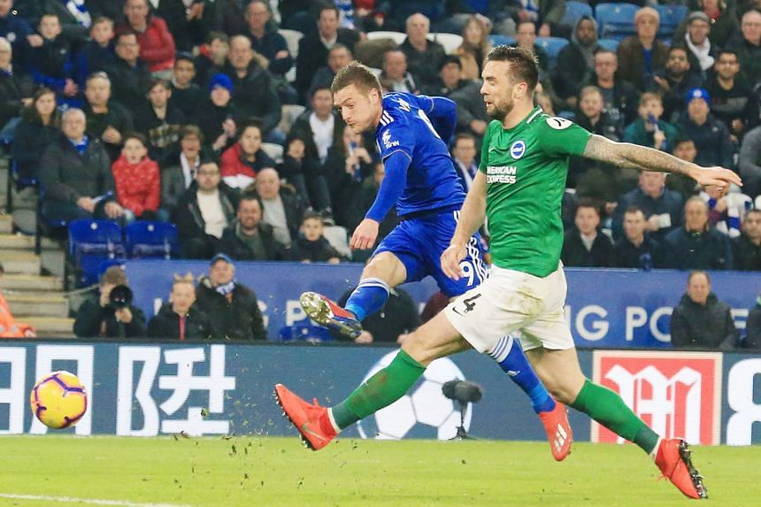 Leicester striker Jamie Vardy getting the better of Brighton defender Shane Duffy to score his team's second goal in the 2-1 Premier League win at the King Power Stadium on Tuesday.