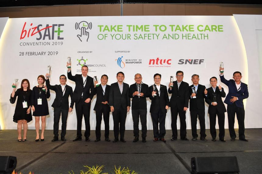 Minister of State for Manpower and National Development Zaqy Mohamad (sixth from left) with winners at the bizSAFE Convention and Awards ceremony.