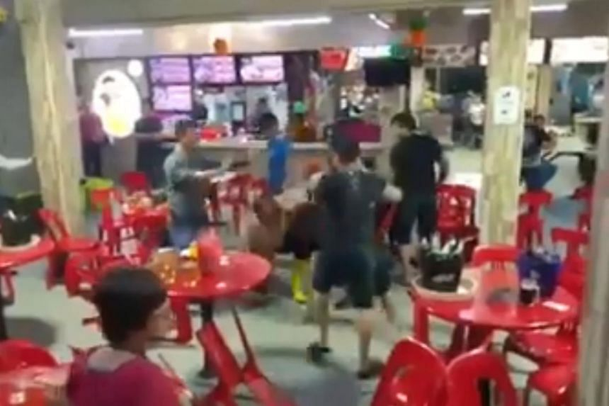 The authorities received several reports of a group of people fighting at a coffee shop in Block 167 Woodlands Street 11 around 9.45pm on Feb 23, 2019.