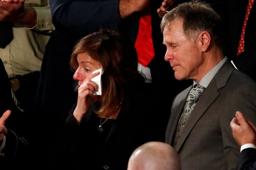 Fred and Cindy Warmbier cry as Donald Trump talks about the death of their son in January 2018.