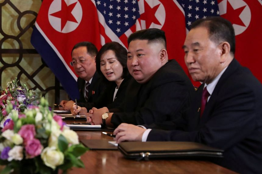 North Korea's leader Kim Jong Un sits alongside Kim Yong Chol, Vice-Chairman of the North Korean Workers' Party Committee, and North Korean Foreign Minister Ri Yong Ho at the extended bilateral meeting with US President Donald Trump (not pictured).