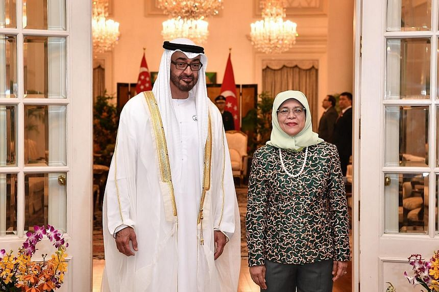 The Crown Prince of Abu Dhabi received a ceremonial welcome at the Istana yesterday morning and paid a courtesy call on President Halimah Yacob, who hosted him to an official lunch.