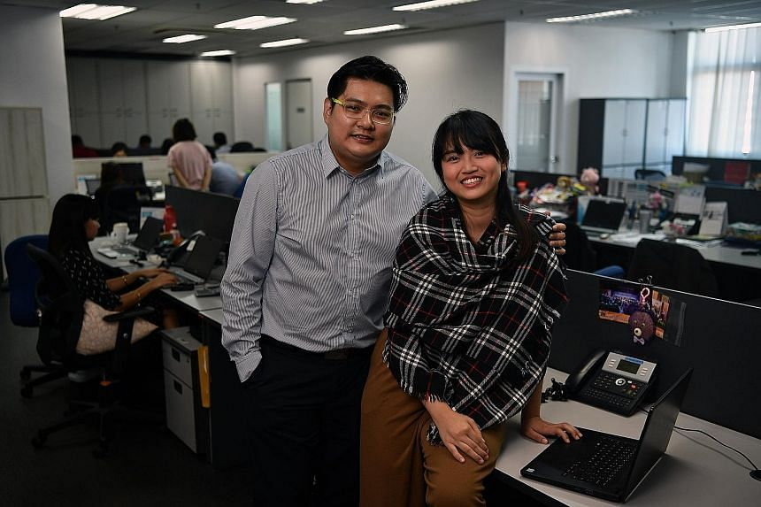 Mr Calvin Lee and his wife Angela Goh both work at local firm M.Tech and regularly tap their employer's flexible work arrangements to juggle work and family.
