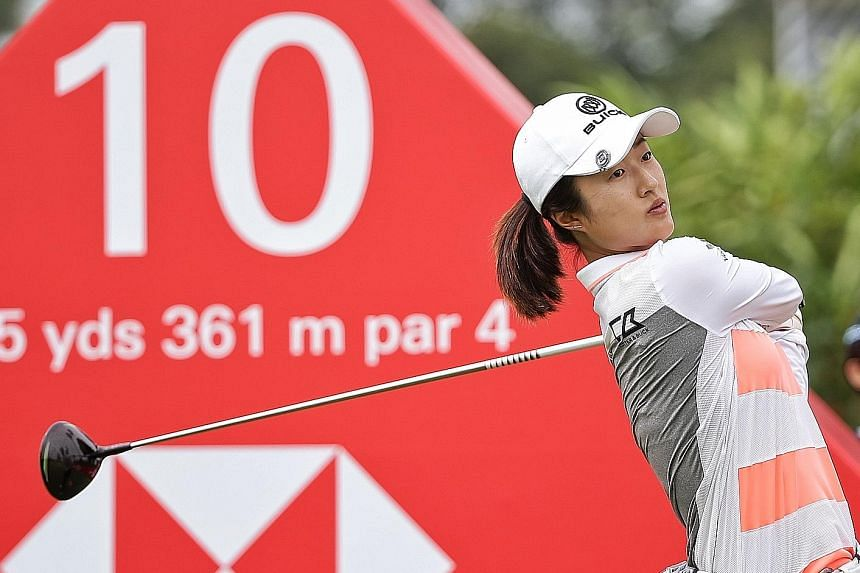 China's Liu Yu teeing off on the 10th hole during the first round of the HSBC Women's World Championship at New Tanjong Course on Sentosa yesterday. She carded four-under 68 and was tied for the lead with four others.