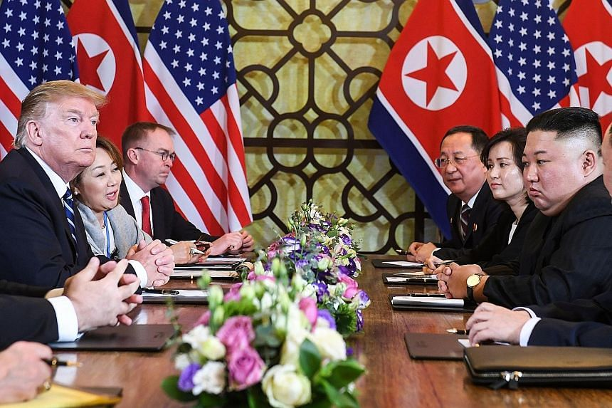US President Donald Trump and North Korean leader Kim Jong Un at a bilateral meeting at the Sofitel Legend Metropole hotel in Hanoi yesterday. Just the night before, the two men had only praise for each other and optimism of a deal to come the follow