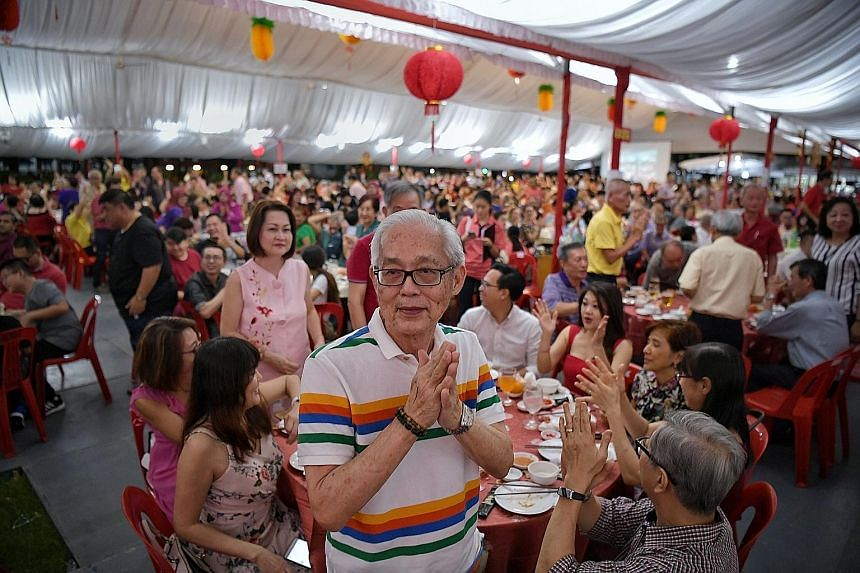 Members of the Merdeka Generation being applauded at the Teck Ghee Chinese New Year dinner in January. Finance Minister Heng Swee Keat yesterday said a cohort-based approach to support the Merdeka Generation and pioneers is appropriate.
