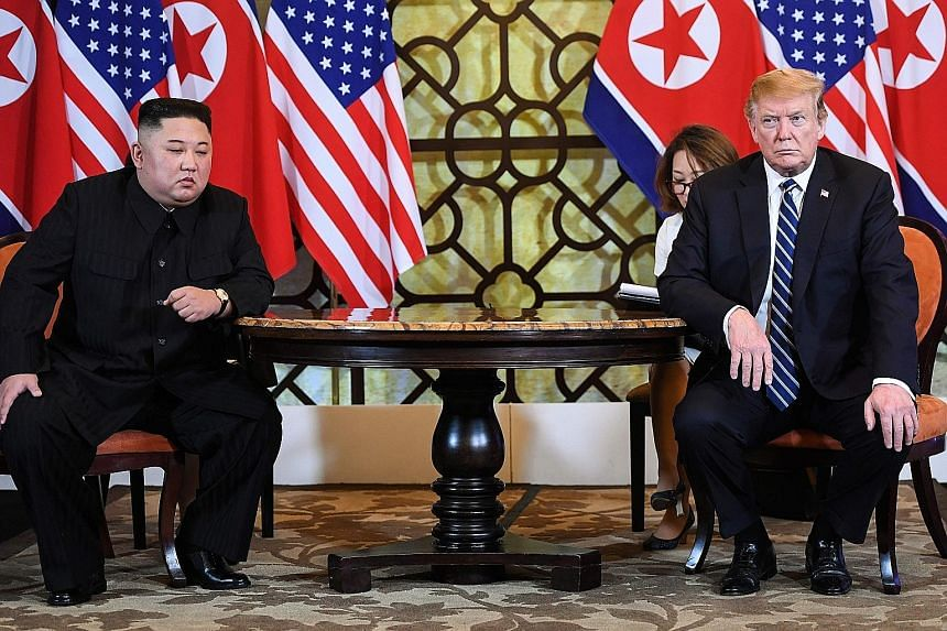 """North Korean leader Kim Jong Un and US President Donald Trump at the Sofitel Legend Metropole Hanoi hotel yesterday. Mr Trump said Pyongyang was willing to denuclearise, """"but in areas lesser than what we want""""."""