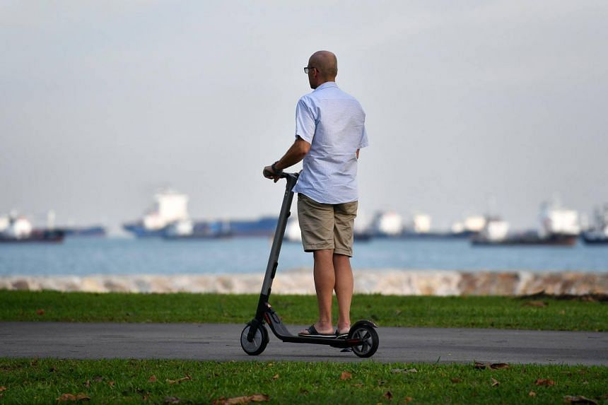 A man riding on a personal mobility device at East Coast Park.