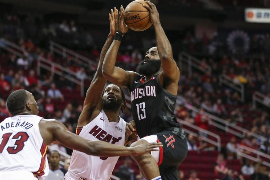Houston Rockets guard James Harden shoots the ball as Miami Heat forward Justise Winslow defends during the first quarter of the game on Feb 28, 2019.