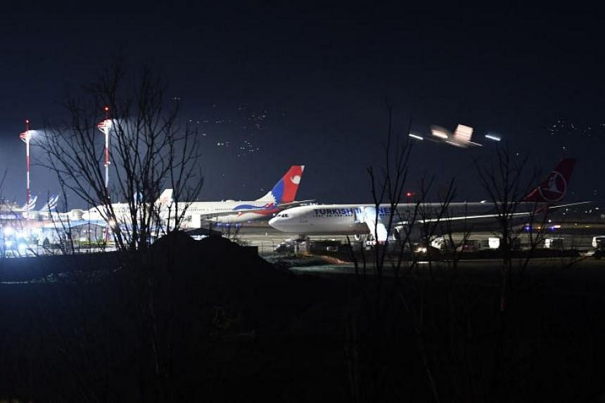 International passenger planes in a parking area at Tribhuvan International Airport in Kathmandu on Feb 27, 2019. Thousands of travellers were left stranded after Pakistan closed its airspace in response to escalating tensions with India.