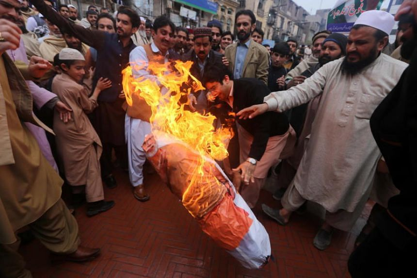 Protesters burn an effigy of Indian Prime Minister Narendra Modi in Peshawar, Pakistan, on March 1, 2019.