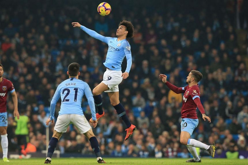 Manchester City's German midfielder Leroy Sane jumps for the ball during the English Premier League football match between Manchester City and West Ham United at the Etihad Stadium in Manchester, north west England, on Feb 27, 2019.