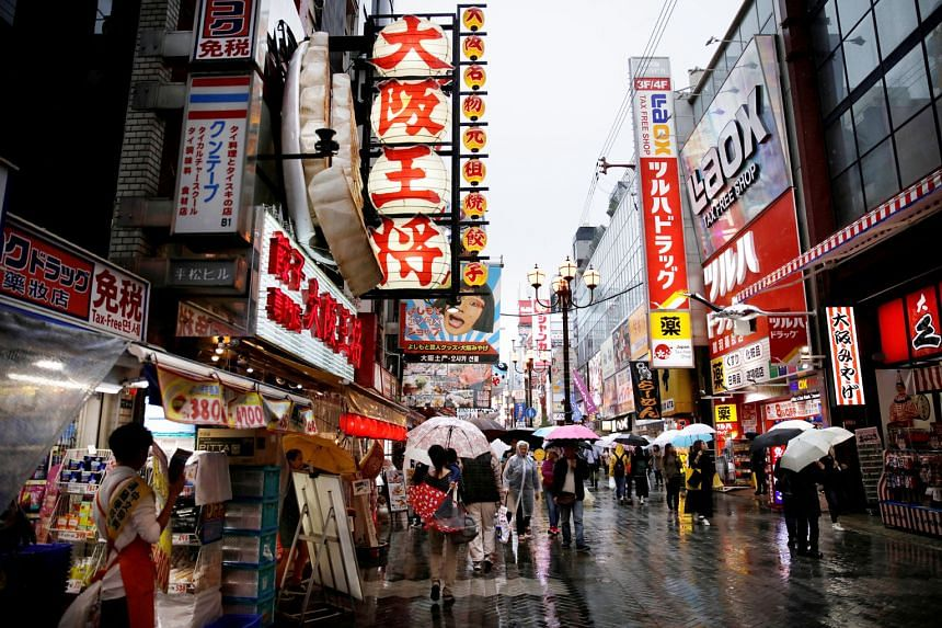 A shopping district in Osaka. Data showed Japan's exports logged the worst drop in more than two years in January as China-bound shipments tumbled, fuelling concerns about the outlook for the export-reliant Japanese economy. Adding to the broader glo