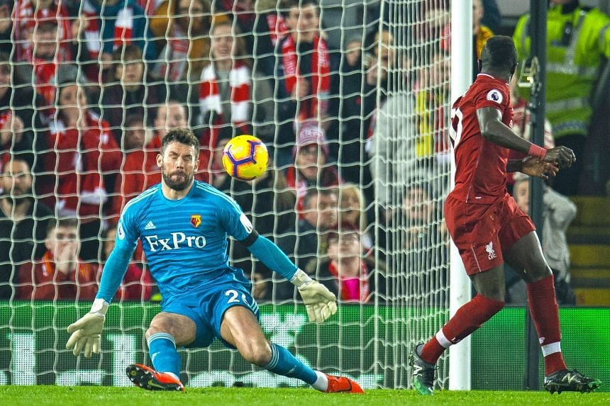 Liverpool forward Sadio Mane scoring an audacious back-heeled goal past Watford goalkeeper Ben Foster in the leaders' 5-0 Premier League victory at Anfield on Wednesday.