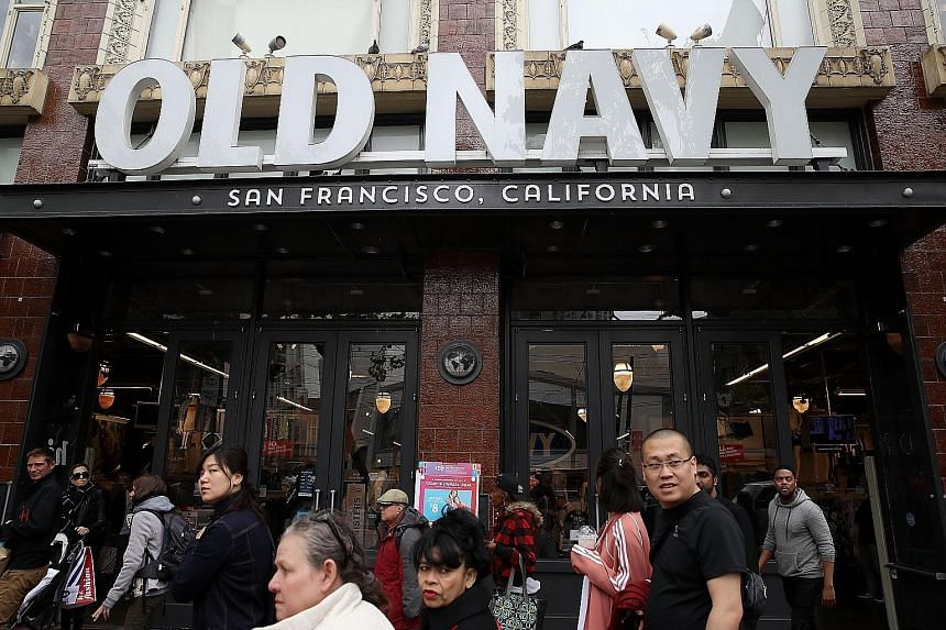 Pedestrians outside an Old Navy store in San Francisco, California. Gap said this week it will split into Old Navy and a new entity which will comprise Gap, Banana Republic and its remaining brands. It will shutter 230 stores under its namesake brand