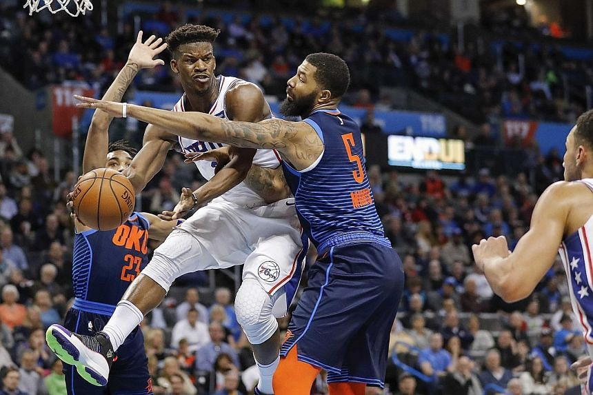 Philadelphia 76ers forward Tobias Harris passing the ball to a teammate under the hand of Oklahoma City Thunder forward Markieff Morris (No. 5) at the Chesapeake Energy Arena on Thursday. The Sixers beat their hosts 108-104, with Harris topping all s