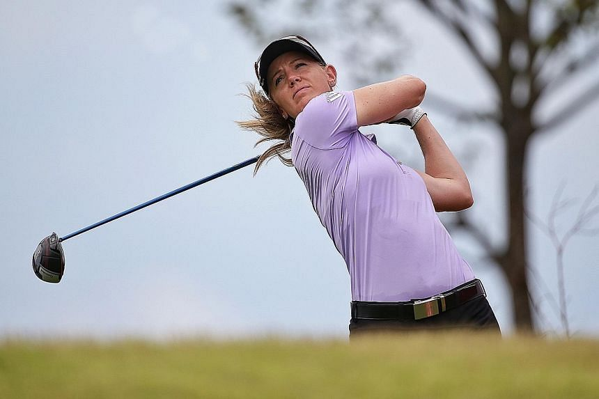 """American golfer Amy Olson teeing off during the HSBC Women's World Championship at the New Tanjong Course in Sentosa yesterday. Olson and world No. 1 Ariya Jutanugarn were accused of committing """"backstopping"""" at the Honda LPGA Thailand last week, but"""