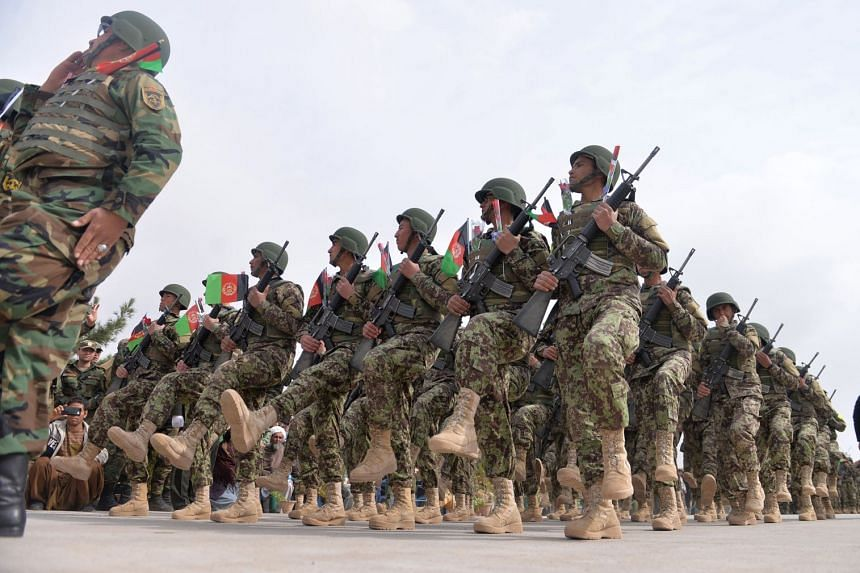 Afghan National Army soldiers march during a military base ceremony on Feb 28, 2019.