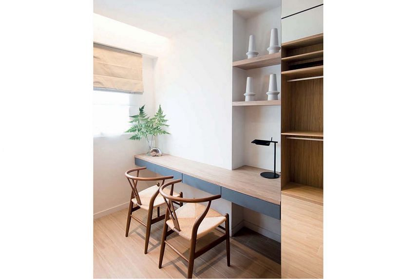 A small study area (above) comes with wall storage, providing ample display spaces for the owners.