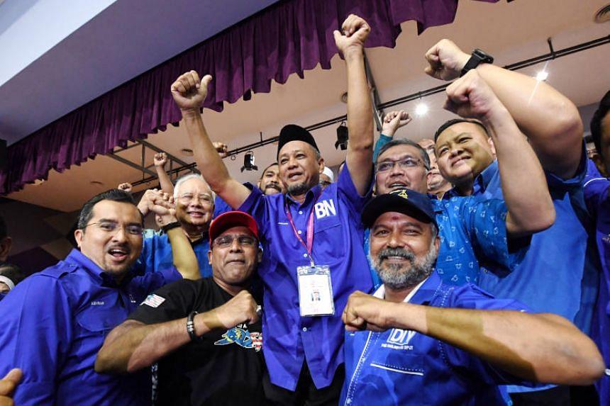 Barisan Nasional's Zakaria Hanafi (centre) won by a majority of 1,914 votes.