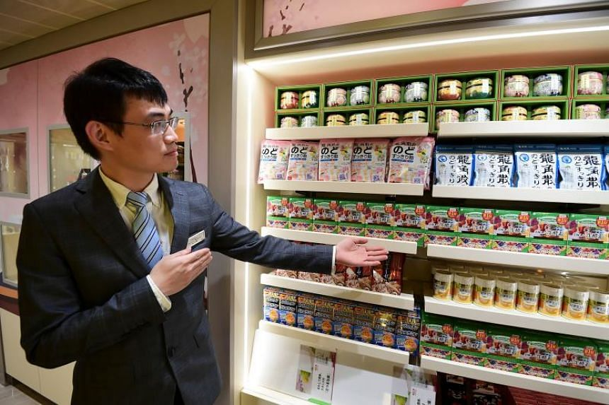 A salesman shows Asian products onboard the Costa Venezia.