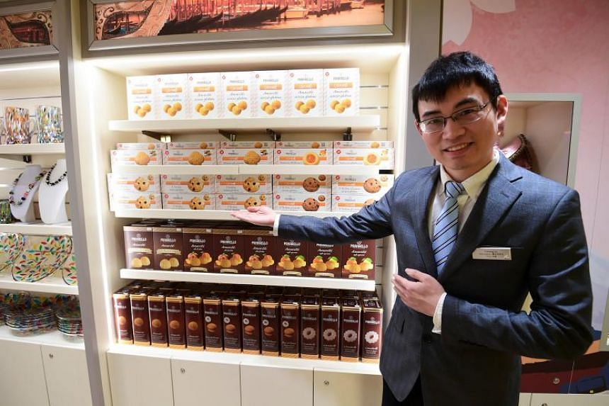 A salesman shows Italian products onboard the Costa Venezia.