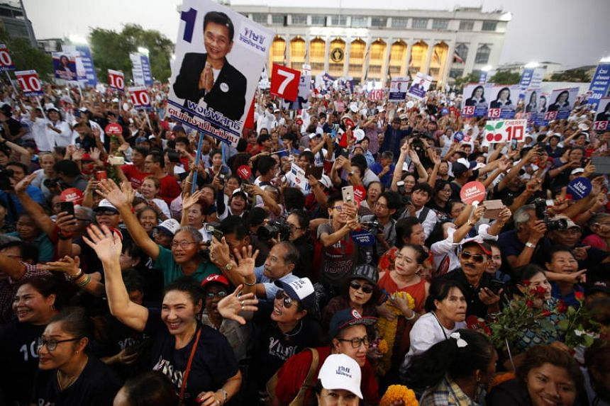 Thousands of people gathered in Bangkok's historic centre late on March 1, 2019, for a defiant campaign by Thai Raksa Chart, one of several parties linked to the Shinawatra clan.