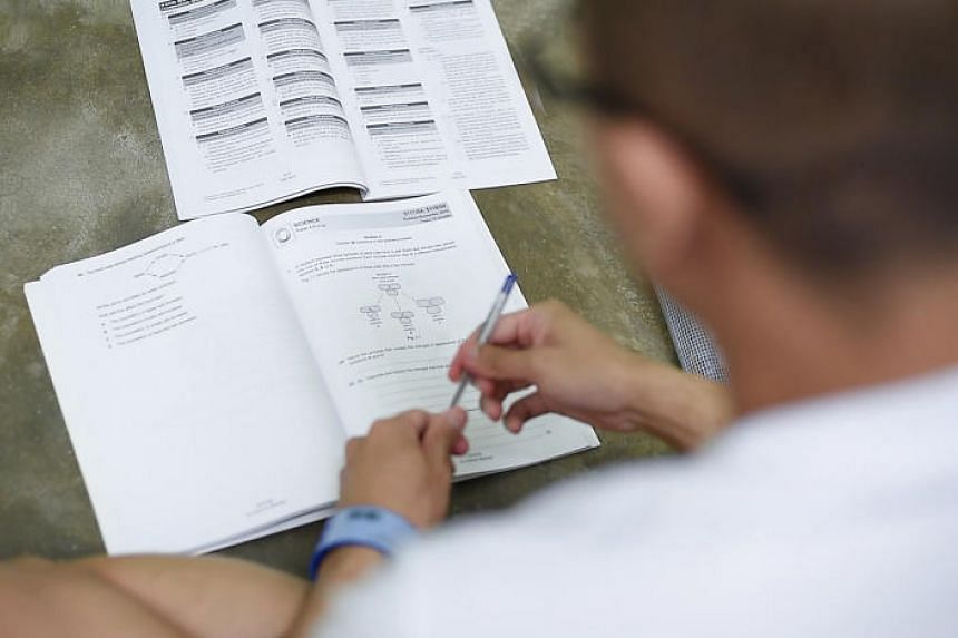 An inmate studying at the Tanah Merah Prison School. The school has teachers teaching O, N and A-level subjects.