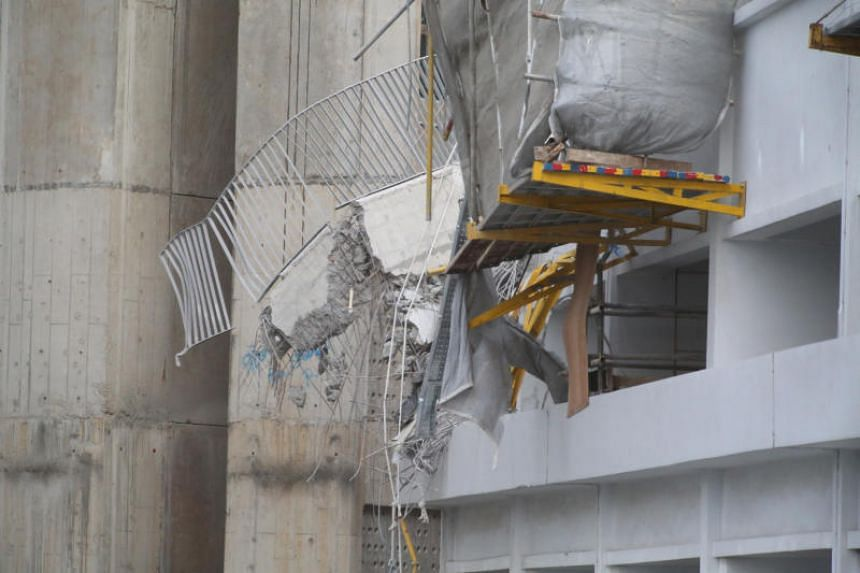 The Singapore Civil Defence Force said that a large concrete beam from a building under construction had collapsed from the upper storeys onto the multi-storey carpark on a lower storey.