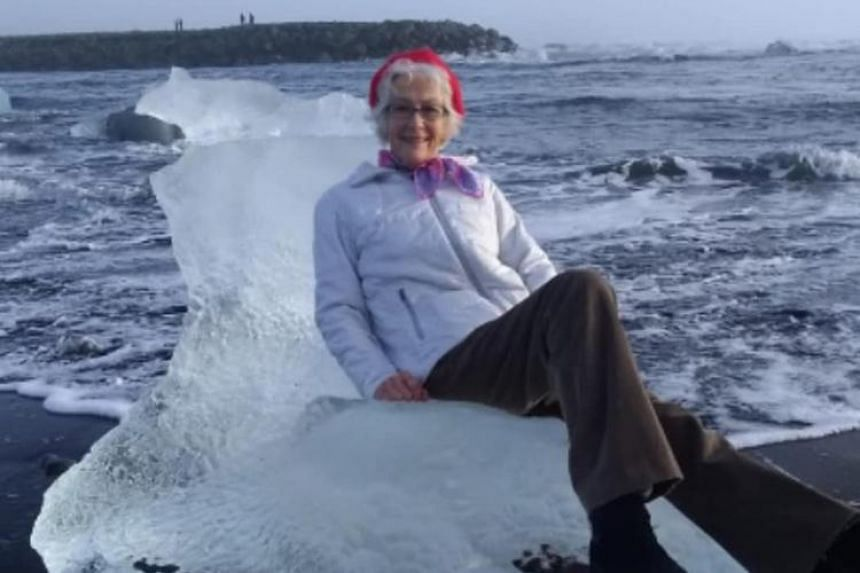 Judith Streng, from Texas, struck a regal pose on a chunk of ice that washed up on Diamond Beach in Jökulsárlón, while her son snapped a picture, until a sudden wave dislodged the icy throne and sending her adrift.