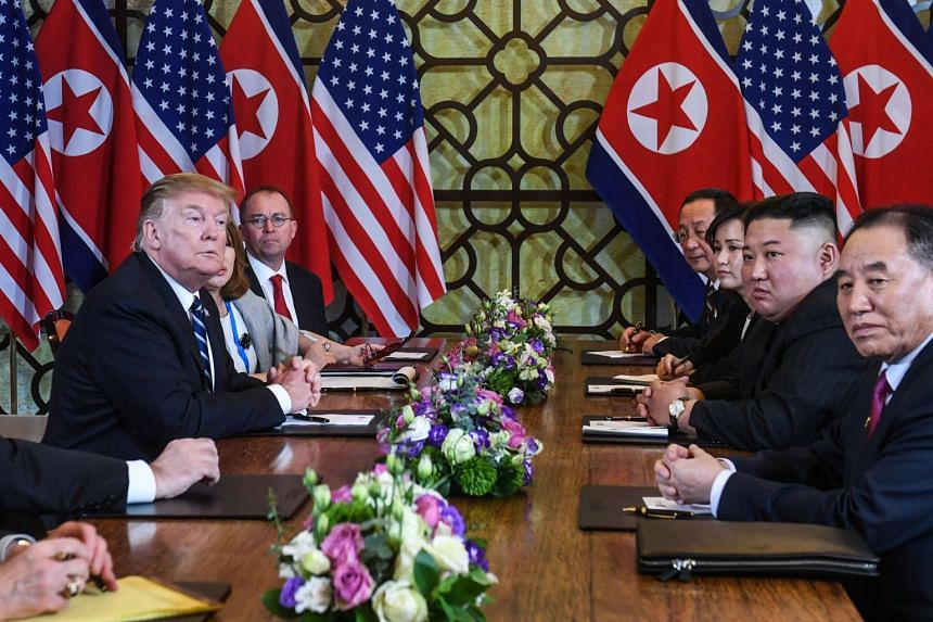 US President Donald Trump (left) and North Korea's leader Kim Jong Un (second, right) during the bilateral meeting at the Sofitel Legend Metropole hotel in Hanoi, on Feb 28, 2019.