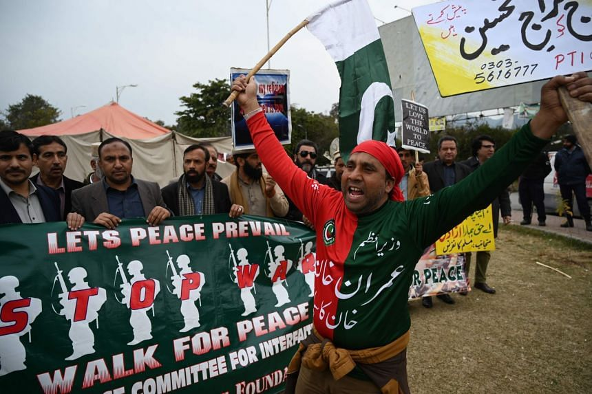 A supporter of the ruling Pakistan Tehreek-e-Insaf (PTI) party chants slogans during a peace rally in Islamabad, on March 1, 2019.