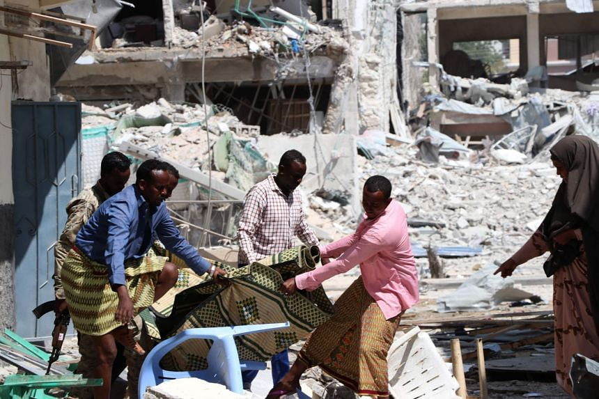 A victim is removed from the Maka Al-Mukarama hotel in the Somalia capital, Mogadishu.