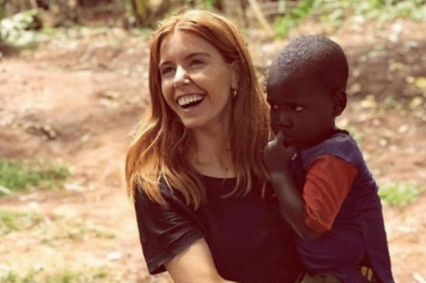 TV presenter Stacey Dooley was filmed holding a black child for British charity Comic Relief.