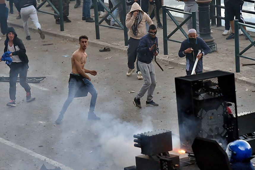 Algerian protesters clash with security forces in the capital Algiers on March 1, 2019.